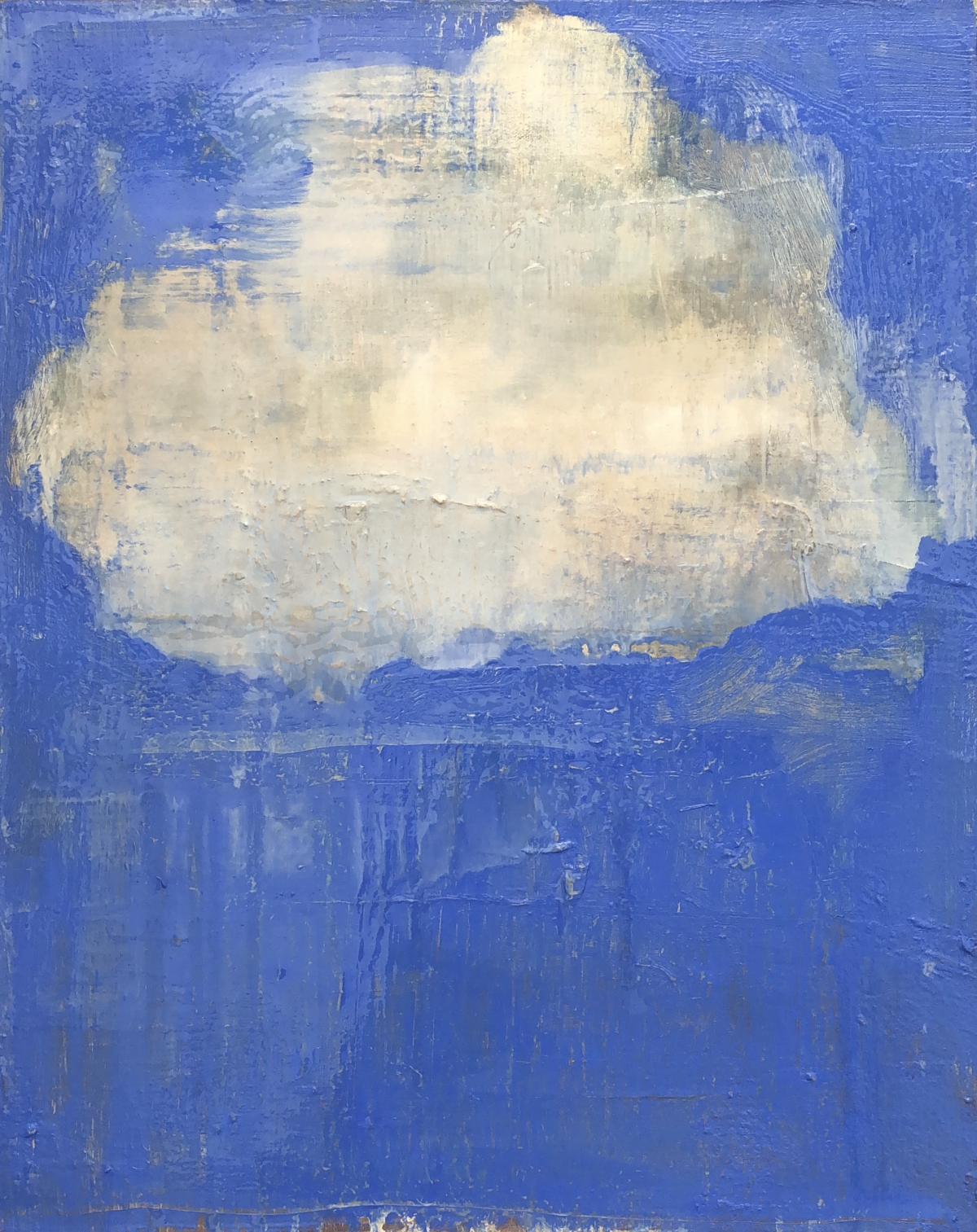 White fluffy cloud against a blue background