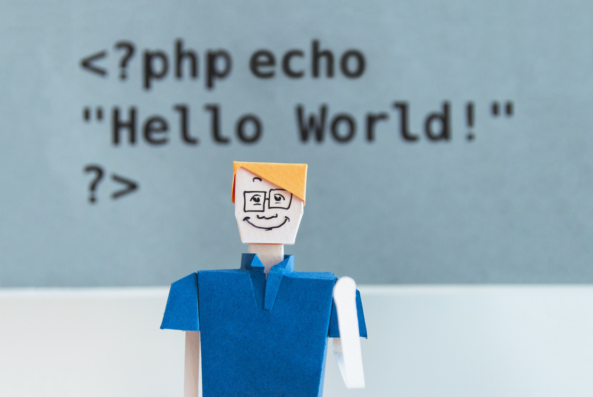 Dark and light blue background with computer still animation of a man wearing blue top and jeans and yellow face.  With the text graphic 'Hello World'.